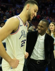 Agent Rich Paul (right) talks with 76ers guard Ben Simmons after a game against the Cavaliers last season.