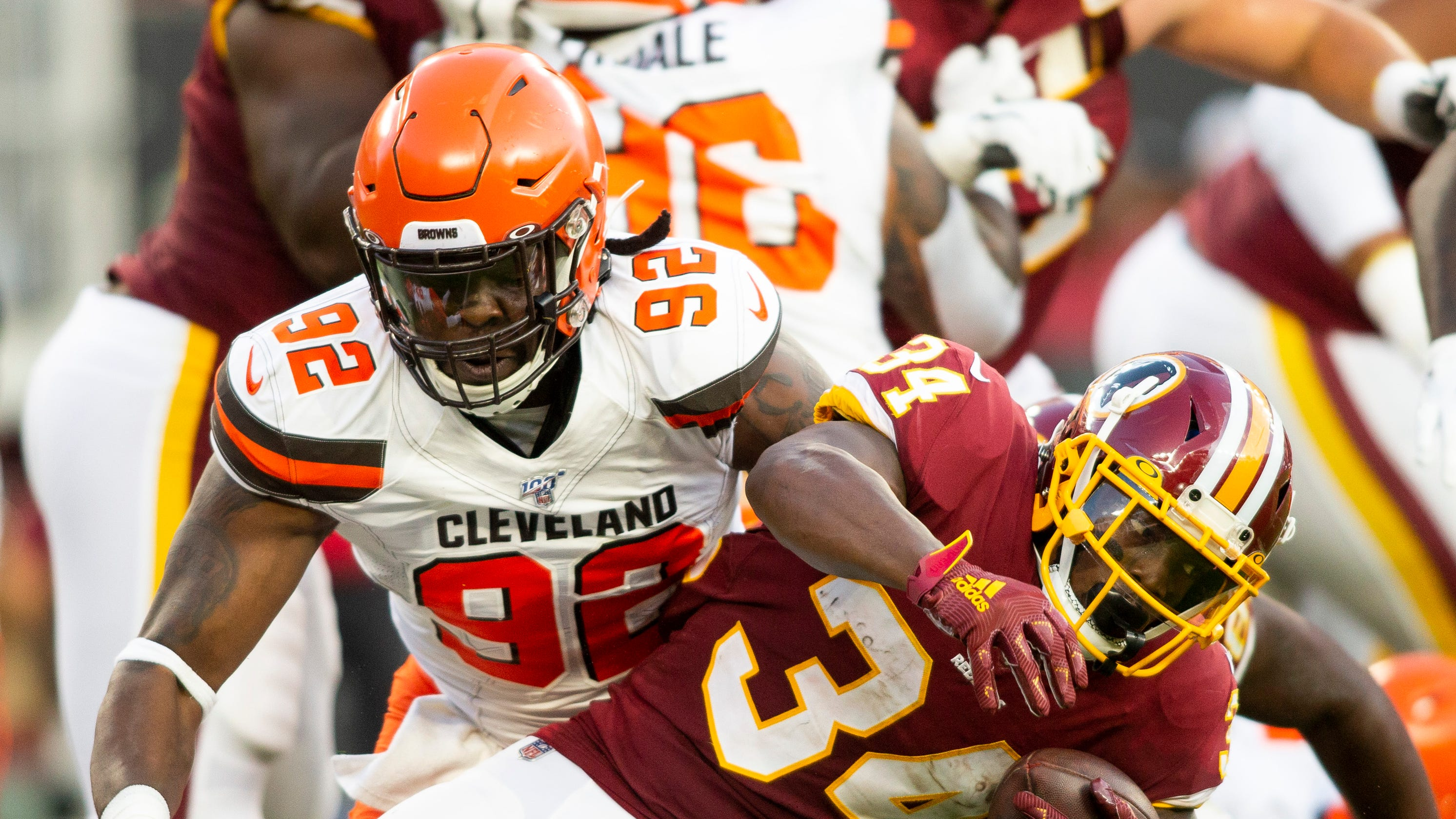 Cleveland Browns DE Chad Thomas immobilized, carted off from practice on backboard