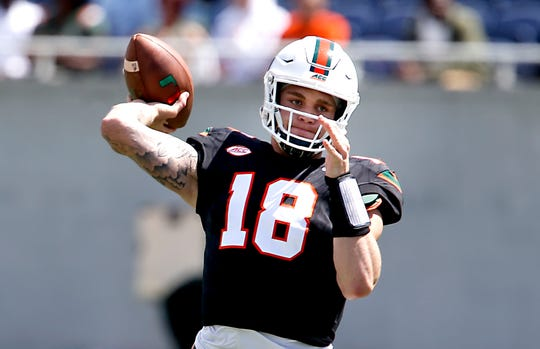 Quarterback Tate Martell throws a pass during warmups before the Miami Hurricanes spring game on April 20, 2019.