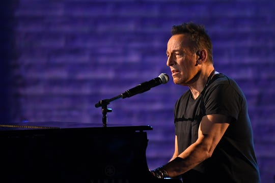 "Bruce Springsteen performs a portion of his solo show ""Springsteen on Broadway"" at the Tony Awards last year."