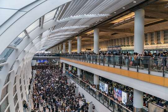 Protesters occupy the Hong Kong International Airport during a demonstration on Aug. 12, 2019.