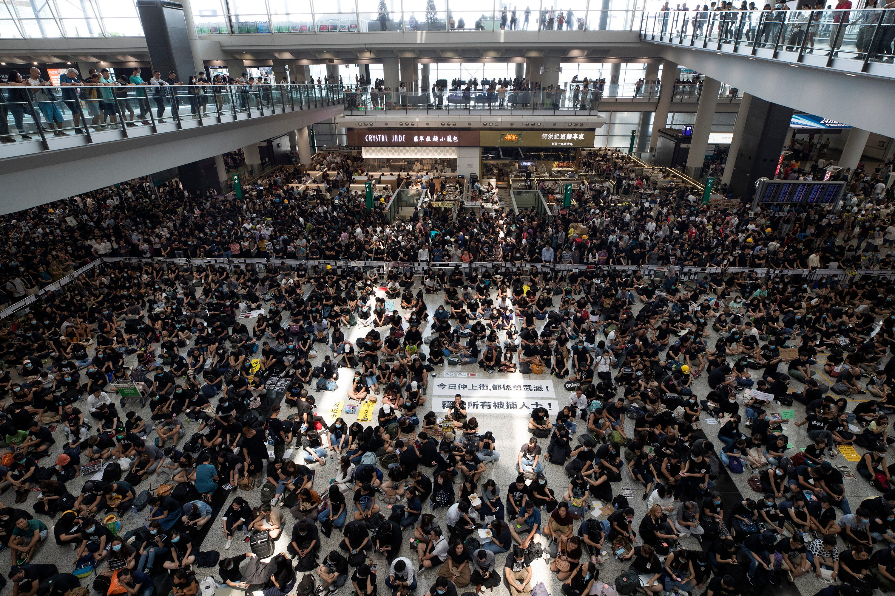 Thousands of protesters shut down Hong Kong International Airport