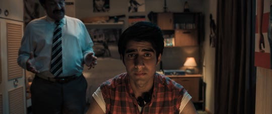 "Javed (Viveik Kalra, center) feels stifled by his more traditional father (Kulvinder Ghir) in ""Blinded by the Light."""