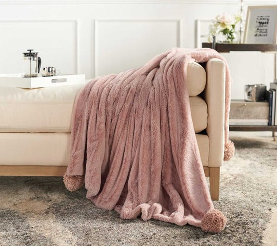 A thow can add warmth to a room, said Jill Martin. This is an oversized throw from her QVC line.