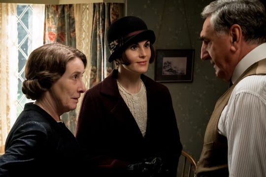 "Lady Mary (Michelle Dockery, center) readies for a royal visit alongside Mrs. Hughes (Phyllis Logan) and Mr. Carson (Jim Carter) in ""Downton Abbey."""