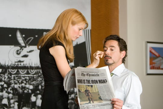 "Gwyneth Paltrow and Robert Downey Jr. in a scene from the 2008 film ""Iron Man."""