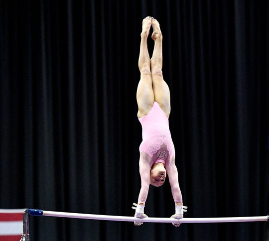 Riley McCusker performs on the uneven bars during the 2019 U.S. Gymnastics Championships at Sprint Center.