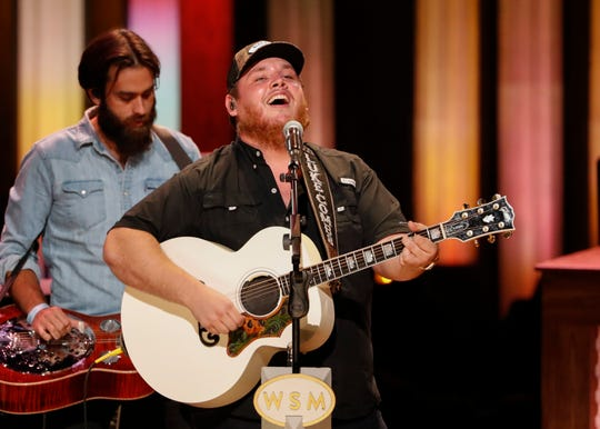 """Luke Combs performs at """"Luke Combs Joins the Grand Ole Opry Family,"""" at the Grand Ole Opry, Tuesday, July 16, 2019, in Nashville."""