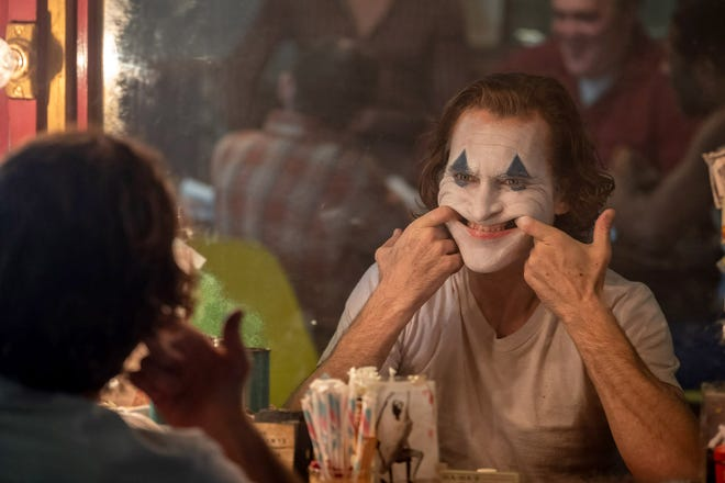 "Clown-for-hire and failed stand-up comedian Arthur Fleck (Joaquin Phoenix) goes down a tragic path of pure mayhem in ""Joker."""