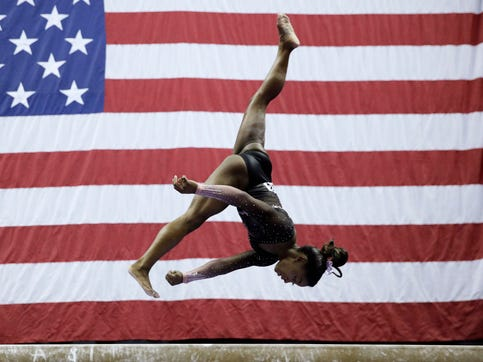Simone Biles competes on the balance beam.