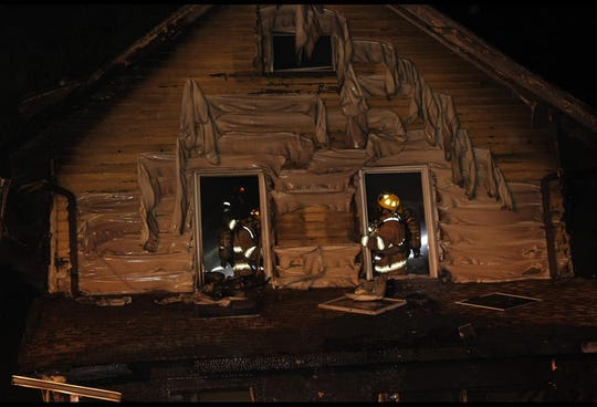 In thIs photo released by the Erie Fire department, firefighters work to put out a house fire in Erie, Pennsylvania, on Aug. 11, 2019.
