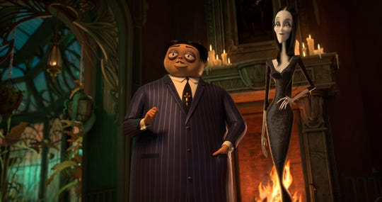 "Gomez (voiced by Oscar Isaac, left) and Morticia Addams (Charlize Theron) move their brood to New Jersey in the animated ""The Addams Family."""