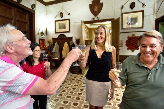 Countess Alwine Federico toasts tour group members in her home, Palazzo Conte Federico — one of the oldest dwellings in Palermo, Sicily.