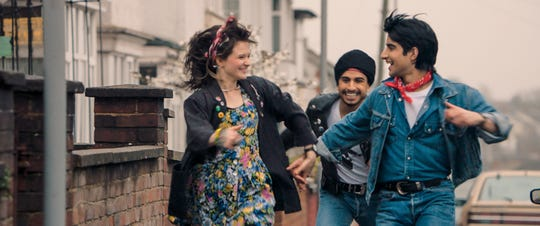 "Eliza (Nell Williams, left), Roops (Aaron Phagura) and Javed (Viveik Kalra) gallivant through town singing ""Born to Run"" in ""Blinded by the Light."""