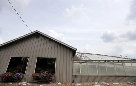 Twigs & Vines Floral in Appleton is open, but its attached greenhouse was destroyed by a storm that came through Appleton on July 20.