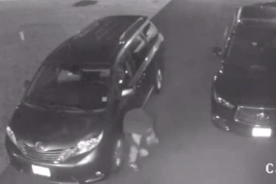 A photo captured on a surveillance video of a suspect slashing multiple tires