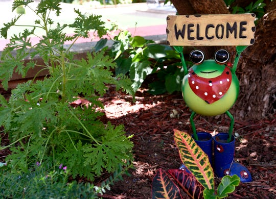 A frog statuette greets visitors to the Bill and Diann Waddill Sensory Garden in the Abilene State Supported Living Center. The garden, named for a former superintendent of the facility, is said to aid residents by stimulating their five senses.
