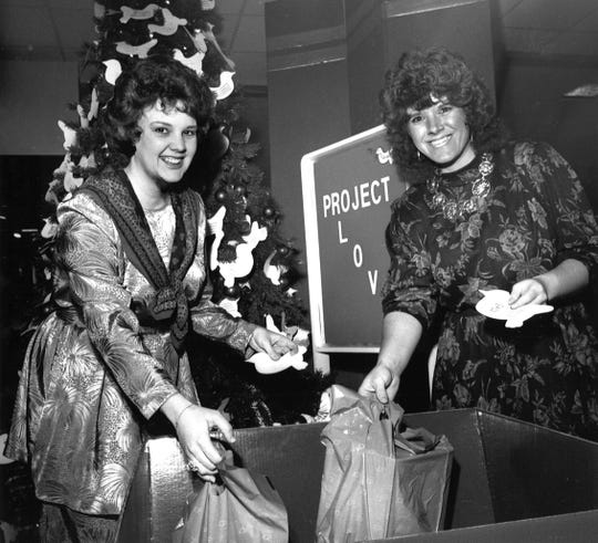 Volunteers Tammy Crowe (left) and Rene Eoff in 1989 prepare for Project Love, a holiday effort for the Abilene State School. Shoppers at JC Penney in the Mall of Abilene were encouraged to pick an item for a resident.