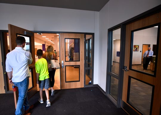 A family enters the building at Wylie East Junior High School from the vestibule Tuesday. The doors in the entrance are controlled by the administrative office at right. Visitors are directed there before being given access to the rest of the school.