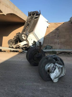 An 18-wheeler went over the embankment at Farm to Market 1235 and Interstate 20 in Merkel Tuesday morning, Aug. 14, 2019. The 21-year-old driver from Fort Worth had only minor injuries.