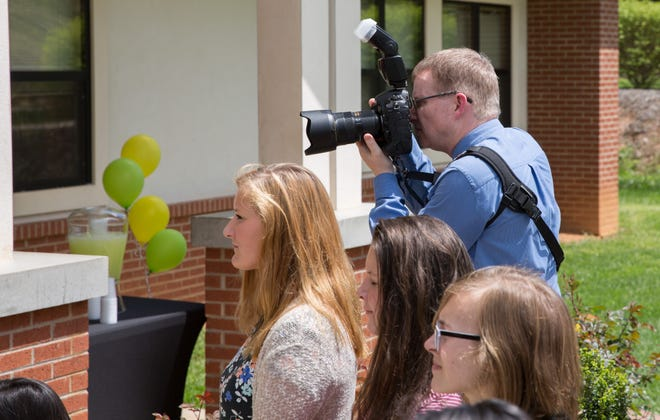David Proffitt, Chief Communications Officer for Jackson County Public Schools, capturing moments during a school event.