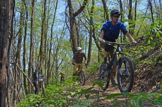 Mountain bikers ride the newly opened Weed Patch Mountain Trail in May 2018 in Hickory Nut Gorge
