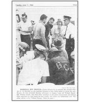 Police officers try to comfort Mrs. Ernest Wallen Sr. of Marshall as she watches firemen in their battle to revive her son, Ernest, 16, who drowned in Goguac Lake off Willard Beach on Monday, June 10, 1963.