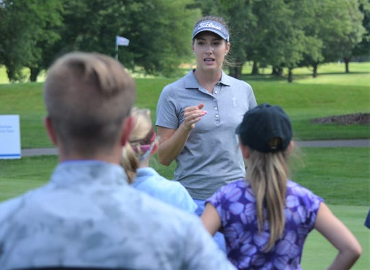 Symetra Tour Player Gabrielle Shipley, who is from the Gull Lake area, talks to young golfers at Battle Creek Country Club during the Kids Clinic at the 2019 FireKeepers Casino Hotel Golf Championship on Tuesday.