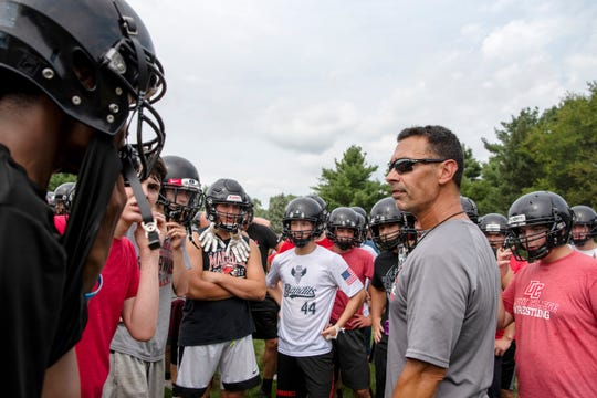 Marshall head coach Bill Dryer conducts the first football practice of the season on Monday, Aug. 12, 2019 at Marshall High School in Marshall, Mich.