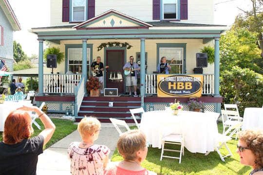 The Humble Beginnings band plays to their fans at Binghamton Porchfest in 2017.