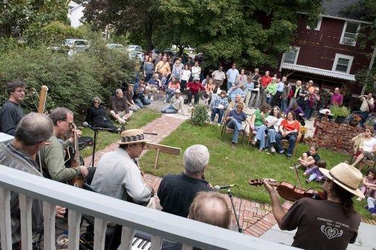 Djug Django draws a large crowd during Binghamton Porchfest in 2012.