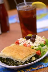 Causeway Diner on Merritt Island has long been a favorite for tasty, filling meals like this spinach pie with a Greek salad.