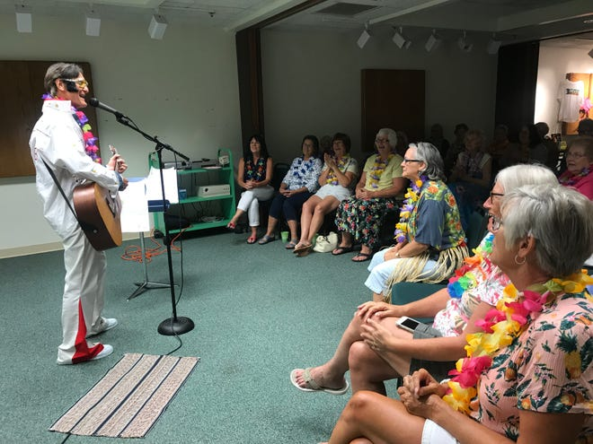 """Lots of laughter and colorful shirts filled Crestline Public Library Monday night as ladies of all ages enjoyed an Elvis-themed ladies night, complete with Elvis impersonator Jim Bauer, Elvis' favorite foods and a screening of the film """"Blue Hawaii."""""""