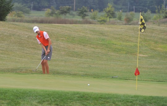 Galion's Nick McMullen chips onto the green at the 9th hole at NorthStar Golf Club.