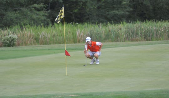 Galion's Matt McMullen eyes his putt on the 8th hole at NorthStar Golf Club.