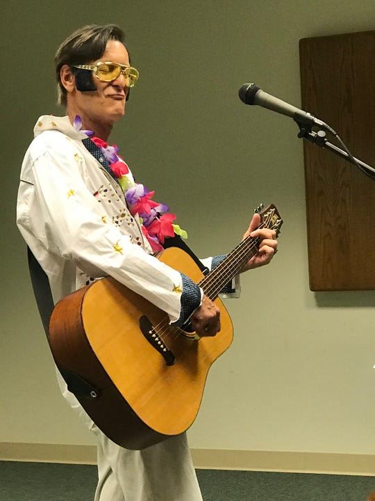 "Cheers, whistles and clapping filled the room as ""Elvis"" impersonator Jim Bauer picked up his guitar to perform such hits as ""Jailhouse Rock,"" ""Love Me Tender,"" and ""Hound Dog."""