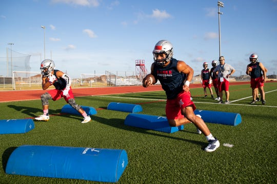 Veterans Memorial's Kobe Piper runs a drill during the first day of practice on Monday, Aug. 12, 2109.