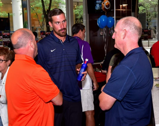 Tony Pike, former Cincinnati Bearcats standout Quarterback, and Michael Asbeck (right), Moeller High School Athletic Driector, share some preseason football thoughts at the 2019 Crosstown Showdown XXII Edition VIP Party at the 4th and Sycamore Skyline Chili, August 12, 2019.