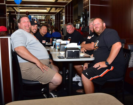 The Lawrenceburg Tigers football staff talks of kicking off the 2019 Crosstown Showdown in their first game of the season as they await their chili dinner at the 2019 Crosstown Showdown XXII Edition VIP Party at the 4th and Sycamore Skyline Chili, August 12, 2019.