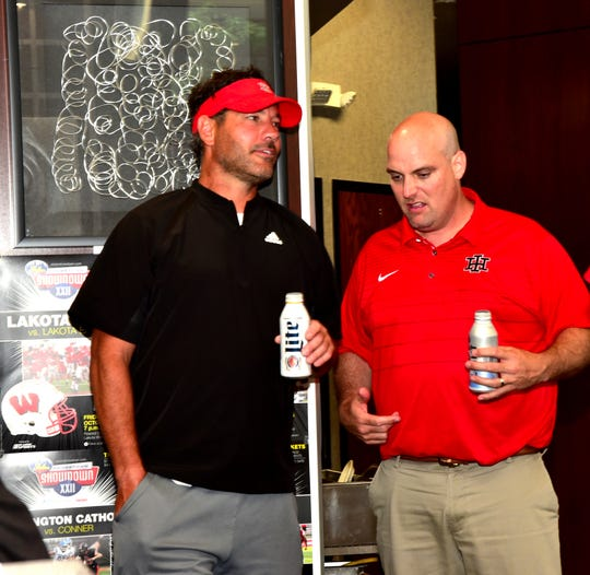 Head coach Tony Arcuri of Indian Hill and assistant coach Matt Haskamp have a cold drink at the 2019 Crosstown Showdown XXII Edition VIP Party at the 4th and Sycamore Skyline Chili, August 12, 2019.