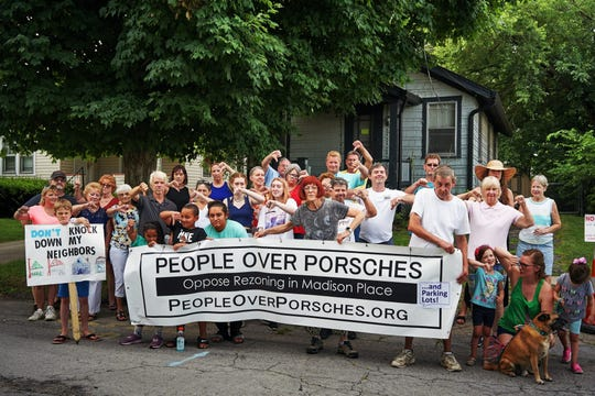 """People Over Porsches And Parking Lots"" is trying to stop the rezoning of residential land in Columbia Township's Madison Place neighborhood for the expansion of a Porsche dealership."