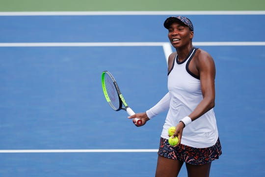 Venus Williams hits tennis balls into the crowd after upsetting defending Western & Southern Open champion Kiki Bertens on center court at the Lindner Family Tennis Center Tuesday, August 13, 2019.