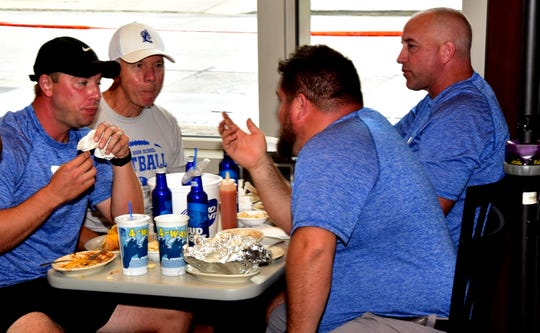 The Reading Blue Devils football staff talk shop and are ready to kickoff the 2019 season looking to makes waves in the Cincinnati Hills League at the 2019 Crosstown Showdown XXII Edition VIP Party at the 4th and Sycamore Skyline Chili, August 12, 2019.
