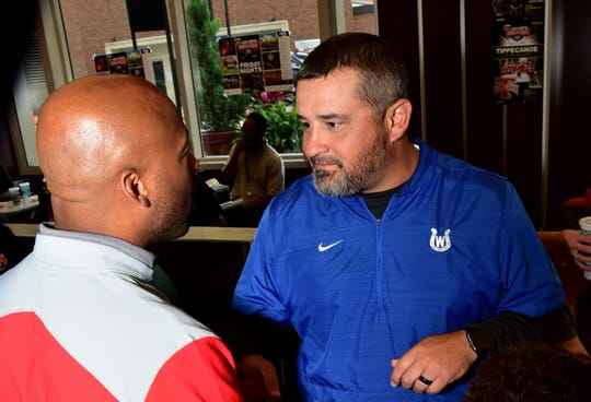 Princeton coach Mike Daniels and Wyoming coach Aaron Hancock talk football shop at the 2019 Crosstown Showdown XXII Edition VIP Party at the 4th and Sycamore Skyline Chili, August 12, 2019.