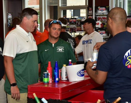 Members of the Mason Comets coaching crew at the 2019 Crosstown Showdown XXII Edition VIP Party at the 4th and Sycamore Skyline Chili, August 12, 2019.
