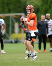 Cincinnati Bengals quarterback Ryan Finley (5) looks to throw during Cincinnati Bengals training camp practice, Tuesday, Aug. 13, 2019, at the practice fields next to Paul Brown Stadium in Cincinnati.
