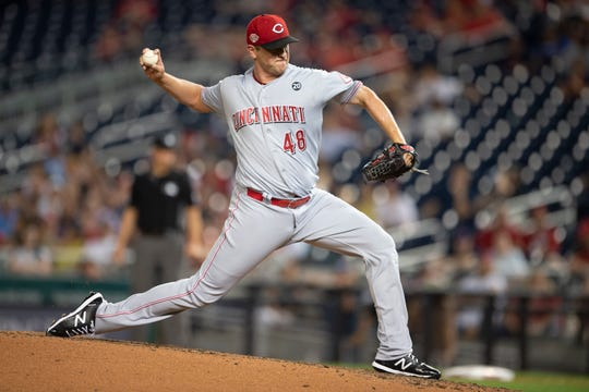 Aug 12, 2019; Washington, DC, USA; Cincinnati Reds relief pitcher Jared Hughes (48) pitches in the seventh inning against the Washington Nationals at Nationals Park.