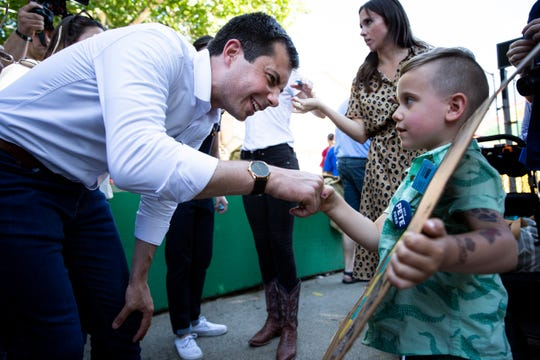 South Bend Indiana Mayor and 2020 Democratic presidential candidate Pete Buttigieg shakes hands with Harris Mayer, 4, of Iowa City before riding the Giant Slide with him during the Iowa State Fair on Tuesday, Aug. 13, 2019 in Des Moines.