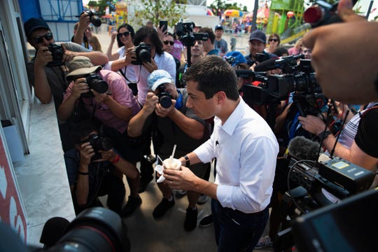 Mayor of South Bend, Ind. and 2020 presidential candidate Pete Buttigieg speaks with reporters and fairgoers before his soapbox speech on August 13, 2019.