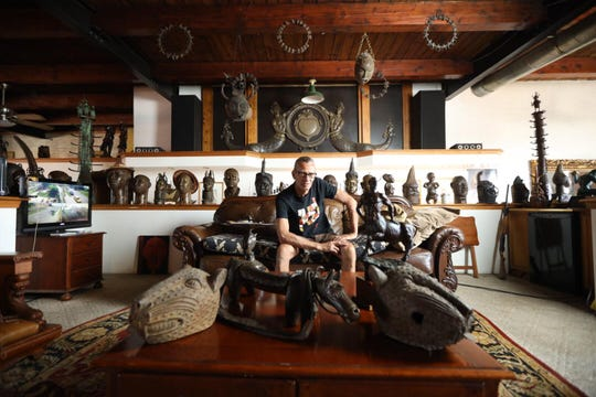 Carlos Nielbock in his home and art gallery, the Detroit Gallery of Metals. The artist's home is a stop on the 2019 Detroit Weird Homes Tour.
